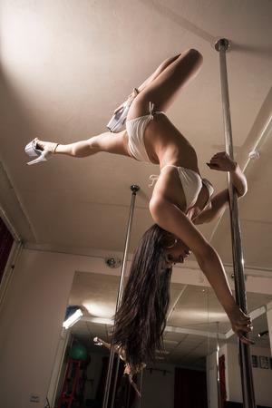 Young slim pole dance woman. photo