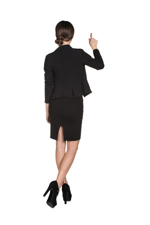 woman full body: Young business girl pressing smth or showing up
