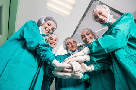 Happy surgeon team. Below view
