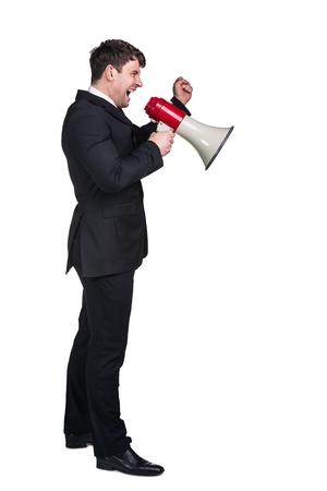 businessman using a megaphone: Portrait of young businessman shouting using megaphone isolated on white background