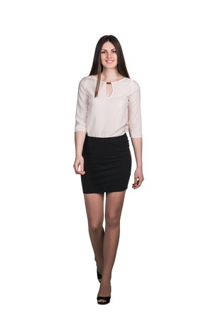 Successful business woman walking - isolated over white photo
