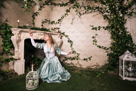 Photo of romantic woman in fairy garden