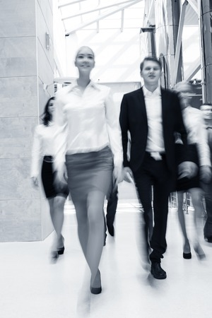 Businesspeople moving along the corridor photo