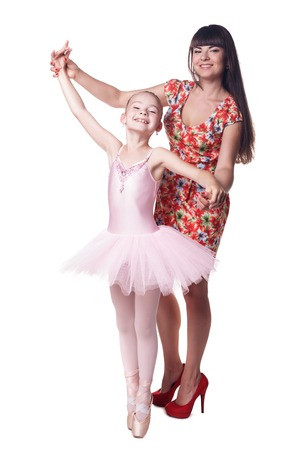 Young attractive ballerina with mother  Isolated on white photo