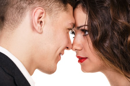 passionately: close up of attractive couple passionately in love looking into each others eyes