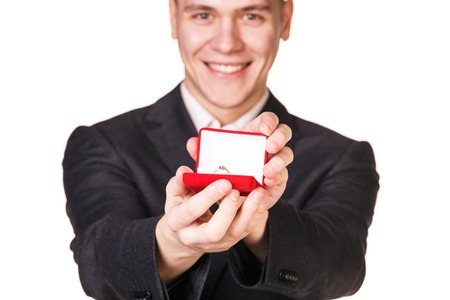 Groom gives the wedding ring in red box photo