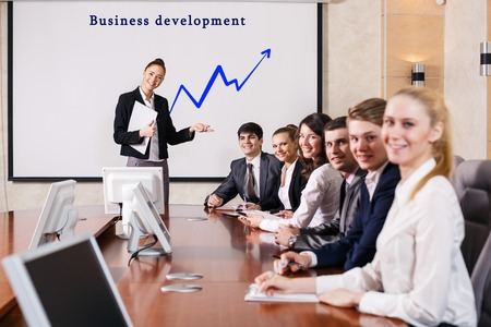 Business consultant answering a question during a meeting at office photo