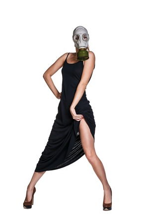 The girl in gas mask on a white  photo