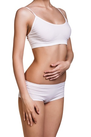 Woman s body isolated over white Healthy lifestyles concept
