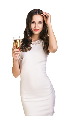 Young celebrating woman in white dress   Beautiful model portrait isolated over white background hold wine glass