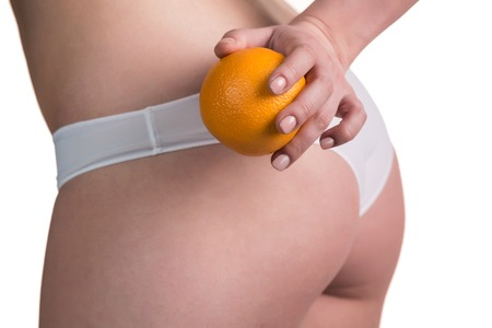 supple: Beautiful slim and supple female buttocks with orange  Isolated on white  Stock Photo