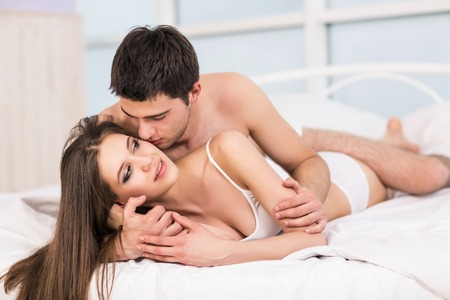 romantic sex: Passionate young couple in bed