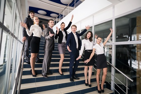 Group of business people smiling standing on stairs photo