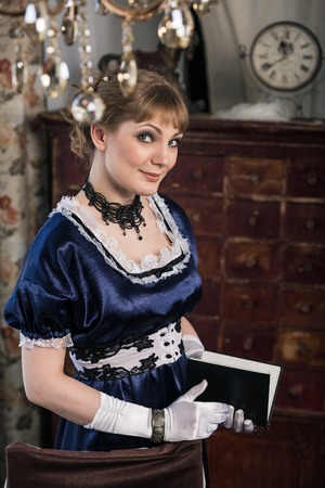Elegant woman dressed in a Civil War era ball gown photo