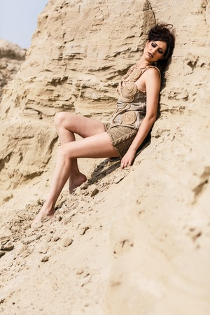 Young woman sitting alone in desert photo