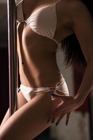 Young slim pole dance woman
