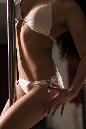 strippers: Young slim pole dance woman