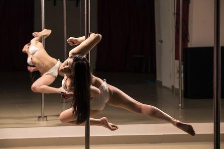Young slim pole dance woman  photo