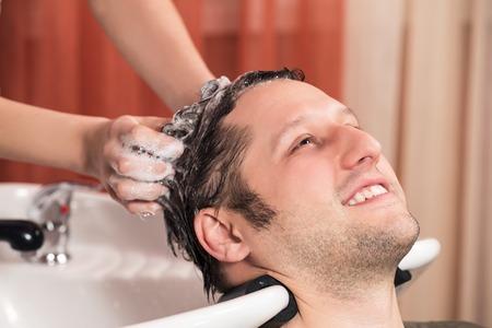 parlour: Washing man hair in beauty parlour hairdressing salon Stock Photo