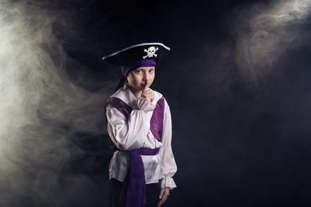Little boy wearing pirate costume photo