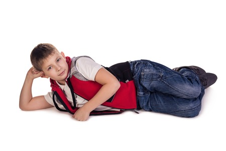 daydream: Small boy laying  Daydream  Isolated on white