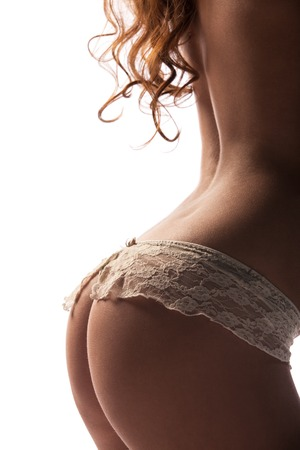 Perfect female sexy buttocks isolated photo