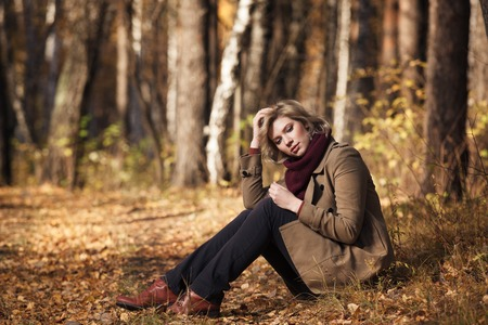 Woman in the autumn forest photo