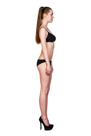 Perfect women body in black underwear isolated on white. photo