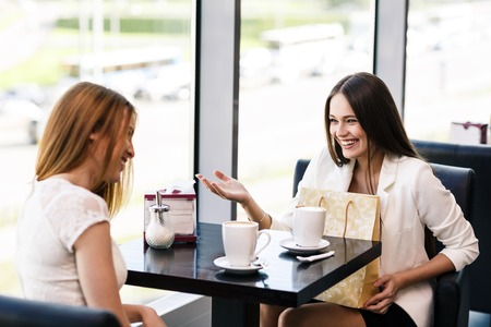 The young women with shopping bag in the cafe photo