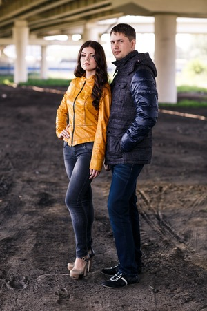 Elegant couple in autumn outdoor jackets photo