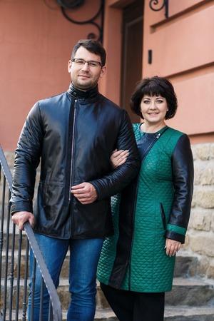 Happy couple hugging on the city street photo