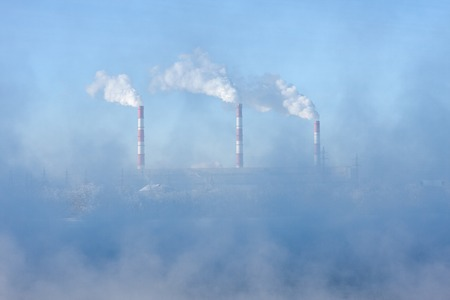 Factory pipes polluting air, environmental problems photo