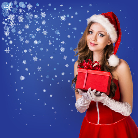 snow maiden: Sexy santa collage. Snow maiden in red dress, on dark blue background with stylized artistic snowflakes