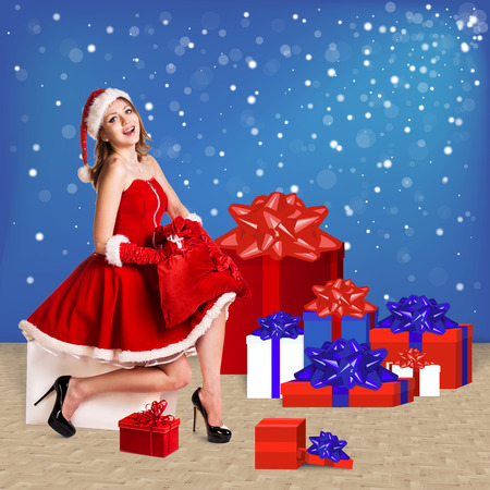 snow maiden: Snow maiden in red dress sitting with a lot of present boxes