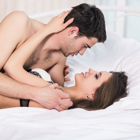 tender passion: Young passionate couple making love in bed