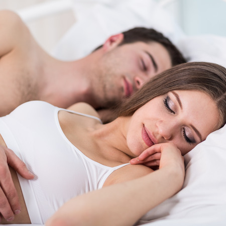Couple in love sleeping in bed photo
