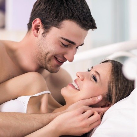 Couple in love in bed photo