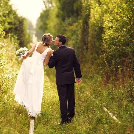 Romantic wedding Couple kissing outdoors