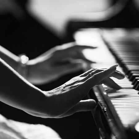 Playing piano close up hands photo