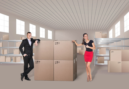 efficiently: Young woman and man in warehouse, they are from the Customer Service