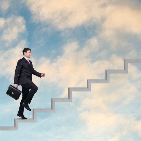 work suit: Image of confident businessman with briefcase walking upstairs
