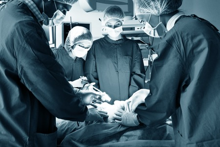 plastic surgery: Surgery team operating in a surgical room