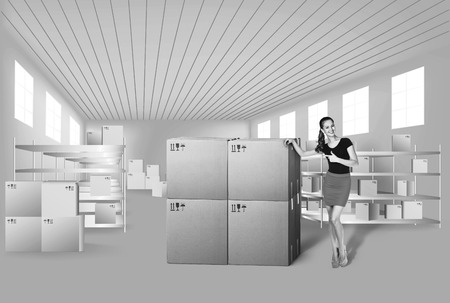 efficiently: Young woman in warehouse, she is from the Customer Service Stock Photo