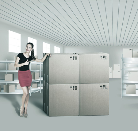 convinced: Young woman in warehouse, she is from the Customer Service Stock Photo