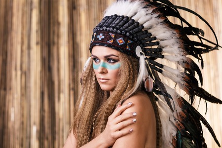 costumes: Woman in war bonnet beauty portrait
