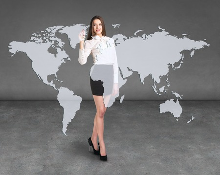 shoulder buttons: Business woman draw a point on a virtual map, a global business