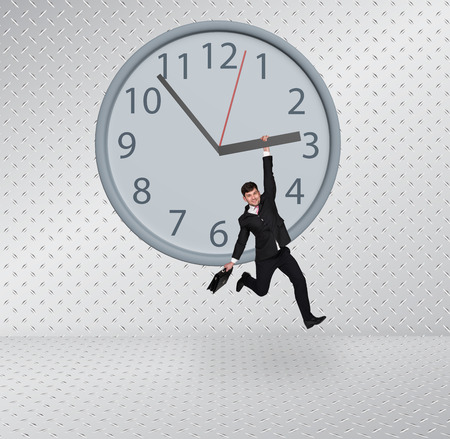 Time concept. Man hanging on a clock photo