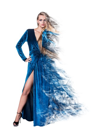 dispersion: Mysterious young womanin in luxurious blue dress on white background. dispersion effect