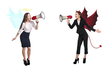 Portrait of angel and devil girls with megaphone and copyspace between them on white background photo