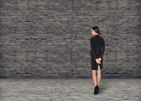 busineswoman: Busineswoman think concept on brick grey background Stock Photo